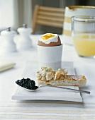 Egg, smoked salmon on toast, Avruga caviar (herring roe)
