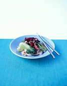 Warm rice noodle salad with beef, pak choi and peanuts
