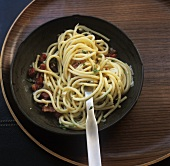 Spaghetti with pancetta, parsley and garlic oil