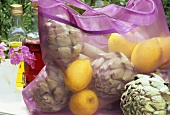 Artichokes and lemons in a shopping bag