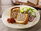 Pork pie with onion chutney and pickled onions (England)