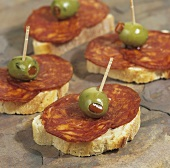 Canapés with organic chorizo and stuffed olives