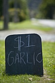 Sign advertising garlic for sale in New Zealand