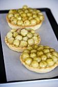 Three gooseberry tarts