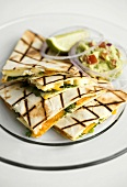 Quesadillas with mango and Brie filling, with guacamole