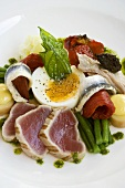 Plate of mixed appetisers: meat, fish and vegetables,