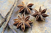 Vanilla pods & star anise on wooden background with cinnamon