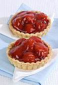 Two strawberry tarts