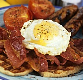English breakfast with waffles, bacon, fried egg