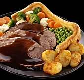 Yorkshire pudding with roast beef, gravy and vegetables