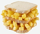 Double-decker chip butty (chip sandwich in white bread)