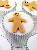 Cupcakes with white icing and gingerbread men