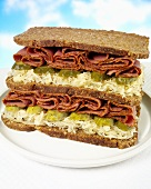 Double-decker pastrami, sauerkraut and gherkin sandwich
