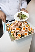 Serving salade niçoise with organic salmon
