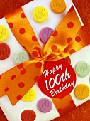 Cake with bow for 100th birthday