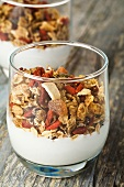 Muesli with dried fruit and yoghurt in a glass