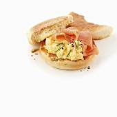Scrambled egg and smoked salmon on English muffin