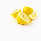 Lemon halves and a wedge of lemon