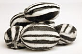 Several black and white striped sweets