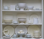 White crockery and eggs on shelves