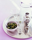 Olives, Martini glass and cocktail shaker