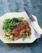 Pork ribs with courgettes and salad garnish