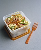 Egg noodles with vegetables & cashews in food storage box