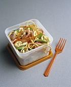 Egg noodles with vegetables & cashews in food storage box
