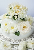 Wedding cake with white roses and silver beads