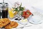 Breakfast: croissants, coffee, orange juice and strawberries