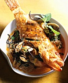 Fried red snapper on Thai soup