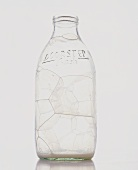 An empty milk bottle with bubbles
