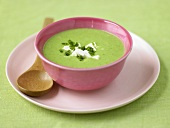 Pea and asparagus soup with feta and chives