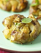 Crushed baked potato with herbs