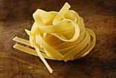 Nest of dried ribbon pasta