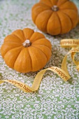 Two baby pumpkins with ribbon