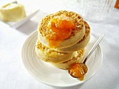 Crumpets with butter and apricot jam