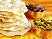 Poppadams with chutneys (India)