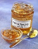 Apple and thyme jelly in jar and small dish