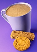 A mug of hot chocolate with biscuits