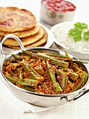 Okra curry (India) with flatbread and rice
