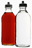 White- and red wine vinegar in bottles