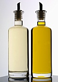White wine vinegar and oil in bottles