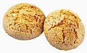 Two almond biscuits on white background