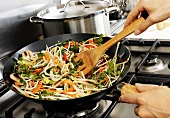 Sautéing vegetables in wok