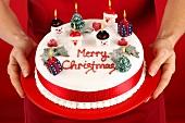 Hands holding a Christmas cake