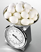 Hard-boiled eggs on kitchen scales