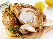 Lemon chicken with thyme, partly carved
