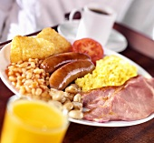 English breakfast: bacon, scrambled egg, sausages, beans etc.