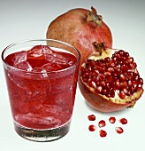 Pomegranate juice with ice cubes